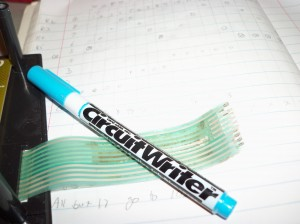 Picture of flex cable and CAIG CircuitWriter pen.