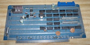 S-100 Vectorboard with custom circuitry.  I think the large 40 pin socket glued in held a printer interface chip.
